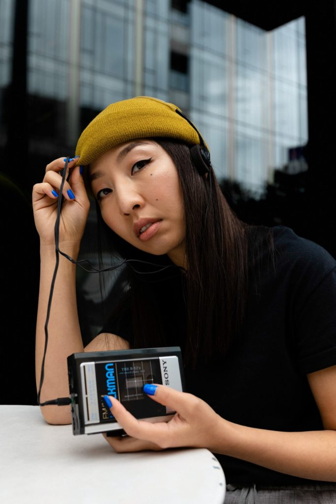 girl with manicured hands and walkman