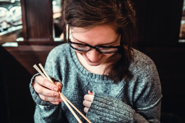manicured girl with chopsticks