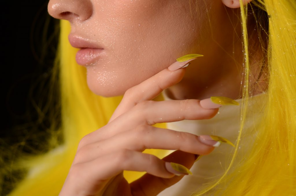This image has an empty alt attribute; its file name is close-up-photo-of-woman-with-yellow-glitter-on-her-face-and-2461180-1024x678.jpg